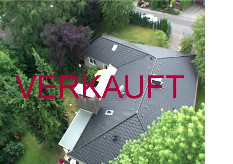 VERKAUFT! Schöner Mehrgenerationen-Bungalow mit großzügigem Gartengrundstück, Einliegerwohnung und Doppelgarage in Monheim-Baumberg